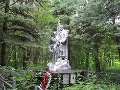 Микишкино, Боевое захоронение и перезахоронение